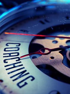 Reloj con manecilla apuntando a la palabra Coaching